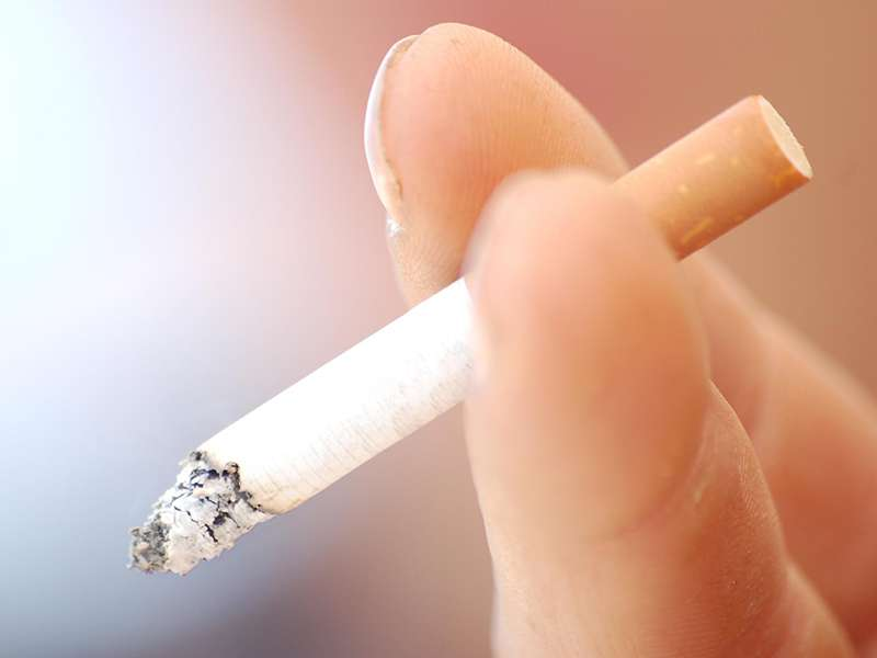 How does smoking affect oral and dental health?